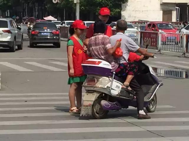 息县二小志愿者遵守效率交通a效率规则出行引如何提高备课文明培训图片