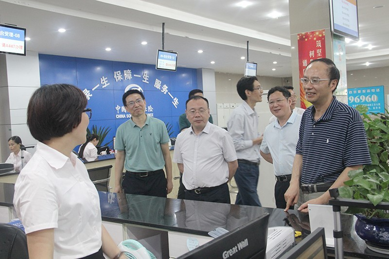 四川省社保局局长周利一行赴广安开展